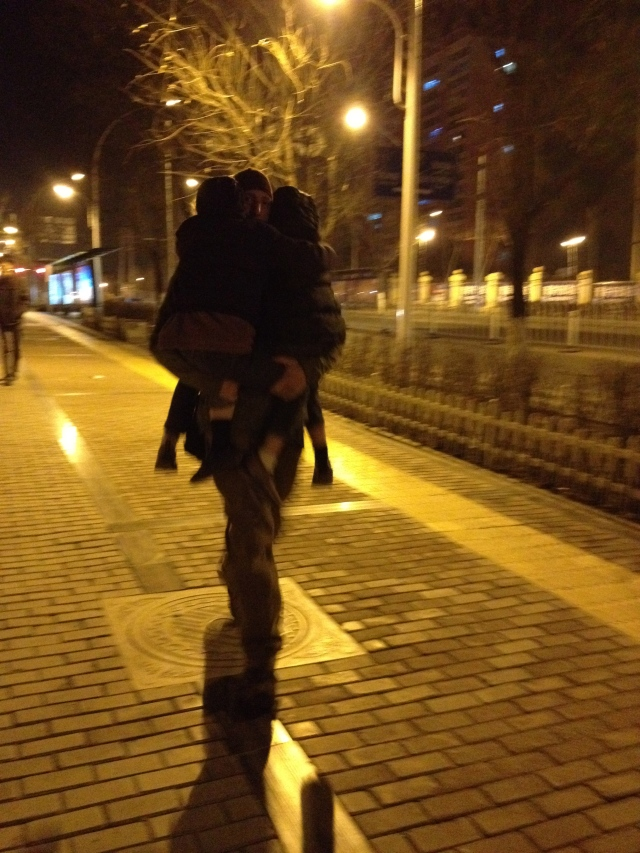 You can't see his face, but that's Dan carrying two of the kiddos home